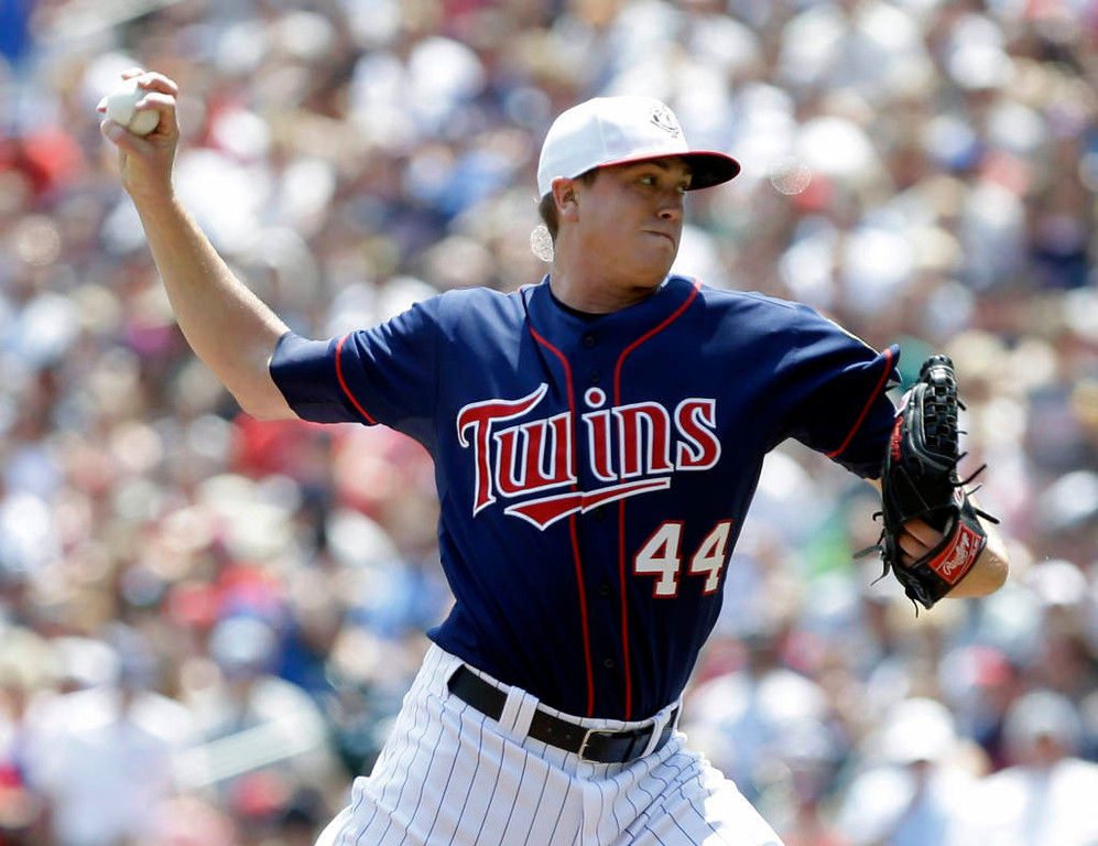 . Minnesota Twins starting pitcher Kyle Gibson throws against the New York Yankees in the first inning. (AP Photo/Jim Mone)