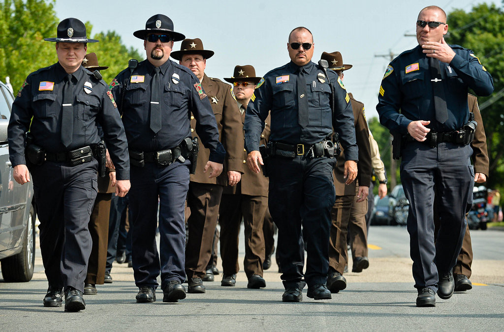 . Law enforcement officers from the Iron Range arrive at St. Stephen\'s for Patrick\'s funeral service. (Pioneer Press: Ben Garvin)