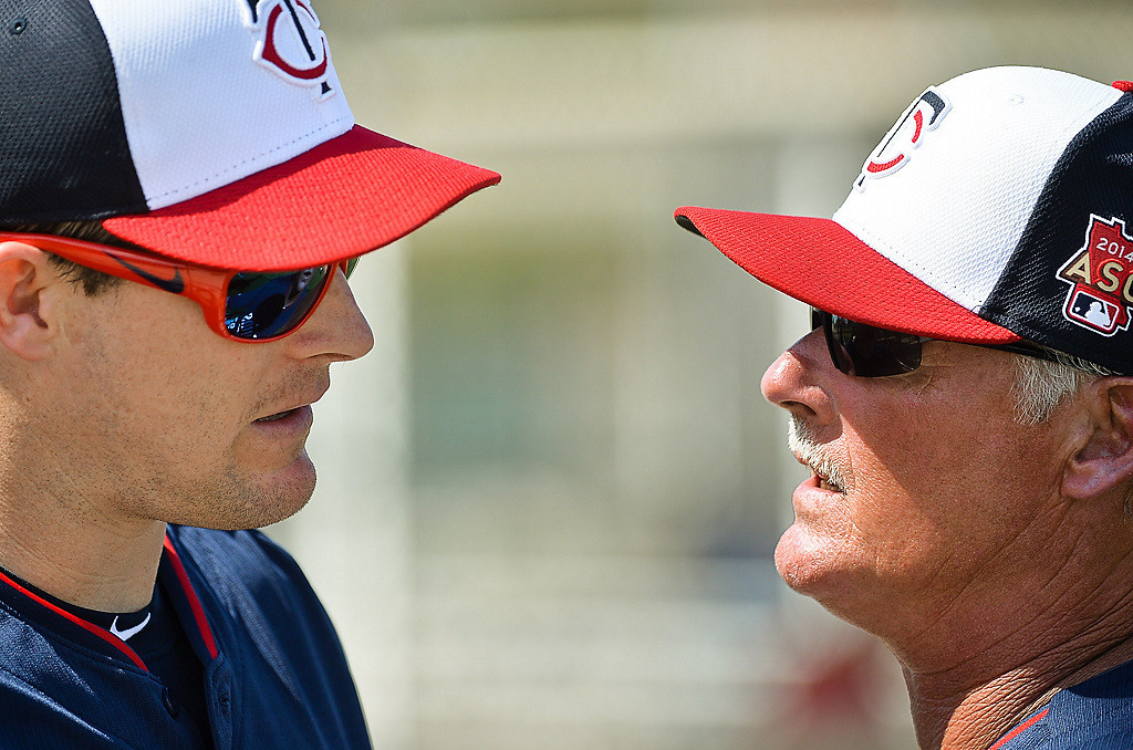 . Twins outfielder Josh Willingham, left, has a word with pitching coach Rick Anderson. (Pioneer Press: Ben Garvin)