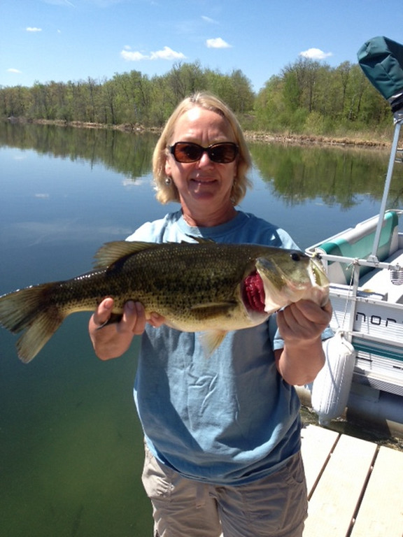 . Betsy McDonough of Lake Elmo caught and released this 5-pound largemouth bass while fishing from the dock at her family\'s cabin on Balm Lake May 27. (Photo courtesy Timothy McDonough)