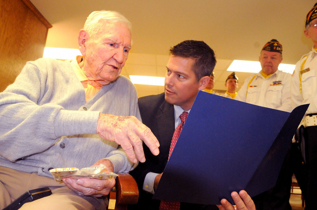 . Burrows looks over his war record with U.S. Rep. Sean Duffy, the Republican representing Wisconsin\'s 7th District. His record includes a personal letter of commendation from Fleet Admiral Chester Nimitz, Commander-in-Chief of the U.S. Pacific Fleet during World War II.  (Pioneer Press: John Doman)