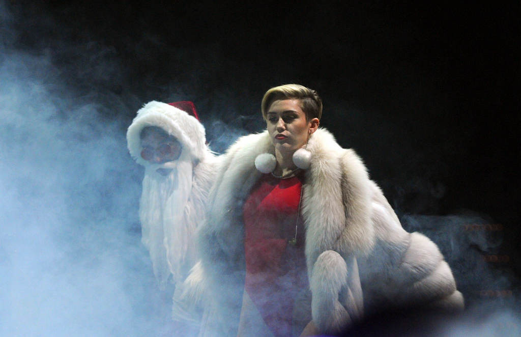 """. Miley Cyrus enters the stage and as the band begins to play \""""Party in the USA\"""" at Xcel Energy Center in St. Paul, Tuesday, December 10, 2013. (Pioneer Press: Chris Polydoroff)"""