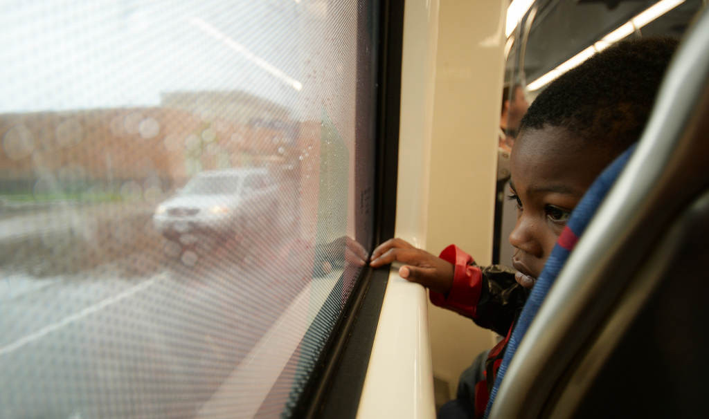 . Marcell Obi-Walker, 4, from St. Paul, looks out the window as University Avenue rolls past. He and his sister and Mom went to the Target Store near Hamline and University and were returning home. (Pioneer Press: John Autey)