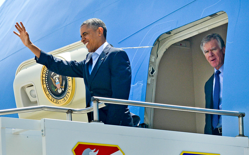. President Barack Obama waves to well-wishers upon his arrival on Air Force One at Minneapolis-St. Paul International airport on Thursday. St. Paul Mayor Chris Coleman is at right. (Pioneer Press: Ben Garvin)