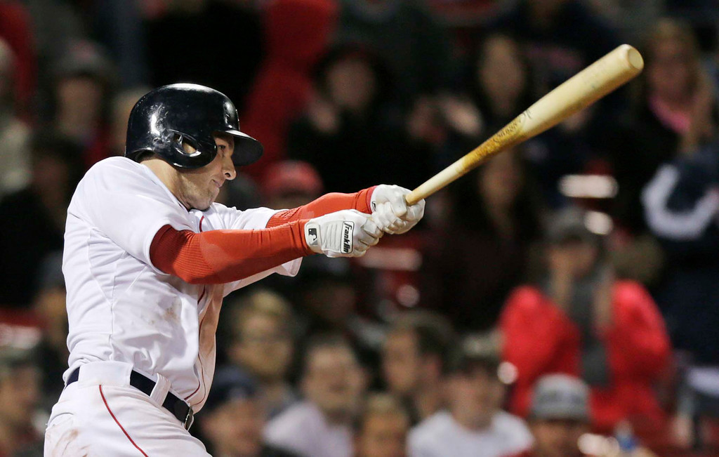 . Boston Red Sox\'s Stephen Drew follows through on his game-winning, RBI double in the 11th inning. The Red Sox won 6-5. (AP Photo/Charles Krupa)