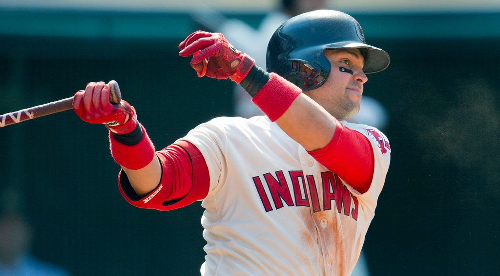 . Cleveland\'s Nick Swisher hits an RBI single during the eighth inning against the Twins. (Photo by Jason Miller/Getty Images)