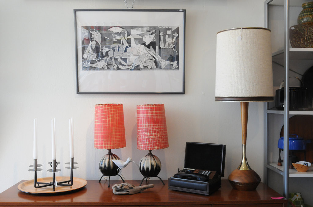 . Home furnishings are sold at  Succotash on Raymond Ave. in St. Paul. From left: Danish candleholder, perfect for hanging on a patio, $48.00; pair of 1950\'s Laurel lamps with original shades, $125.00; Picasso print, $30.00; box phone, $20.00.  (Pioneer Press: Ginger Pinson)