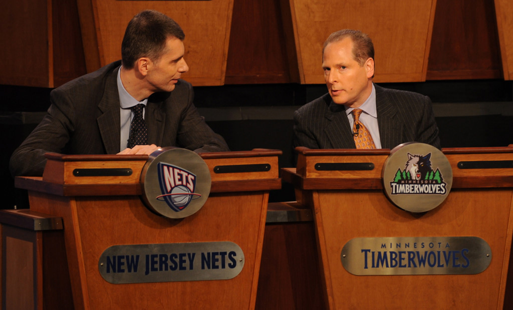 . New Jersey Nets owner Mikhail Prokhorov, left, speaks to David Kahn during the 2010 NBA Draft Lottery at the Studios at NBA Entertainment in Secaucus, New Jersey on May 18, 2010.   (Photo by Jennifer Pottheiser/NBAE via Getty Images)