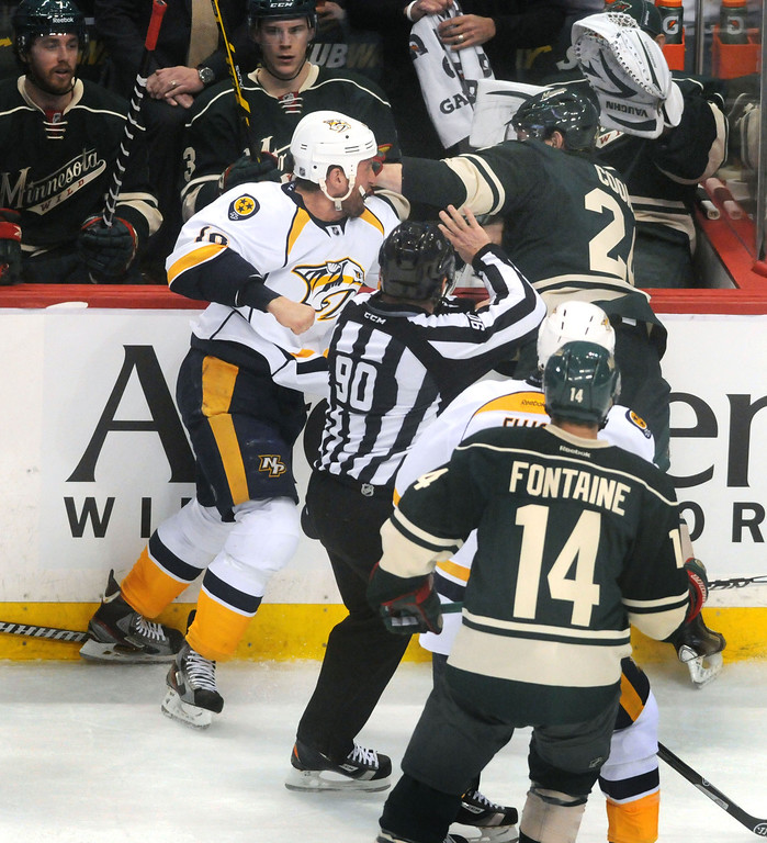 . The Wild\'s Matt Cooke, right, and Nashville\'s Rich Clune fight in the second period as the Minnesota Wild played the Nashville Predators.  Clune was given a 2-minute penalty for crosschecking, 2 minutes for roughing and 10 minutes for misconduct.  (Pioneer Press: Scott Takushi)