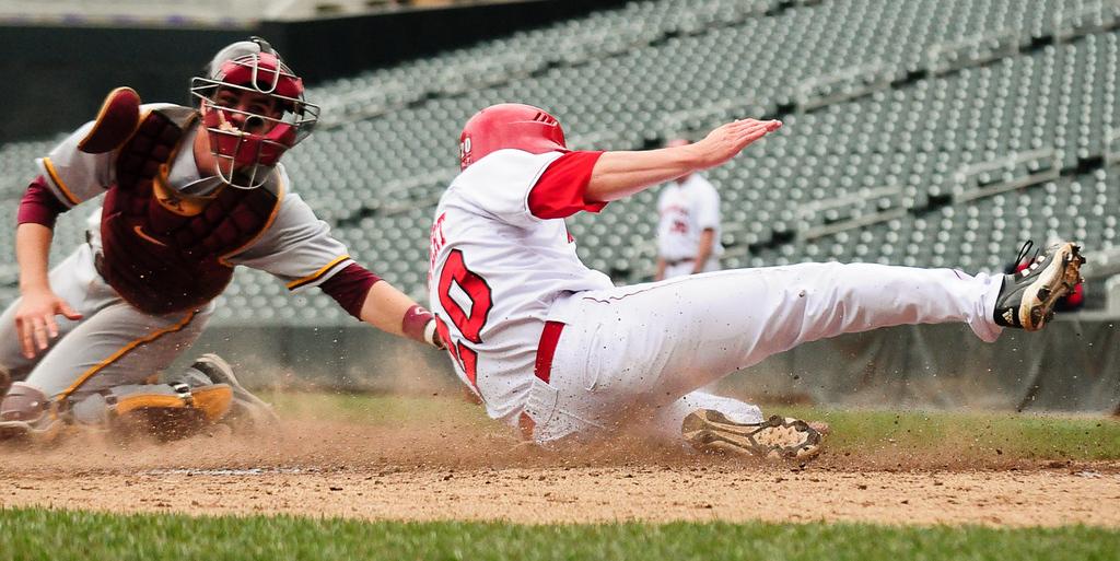 . Nebraska\'s Josh Scheffert slides past the tag of Minnesota catcher Matt Halloran to score in the fourth inning. (Pioneer Press: Ben Garvin)