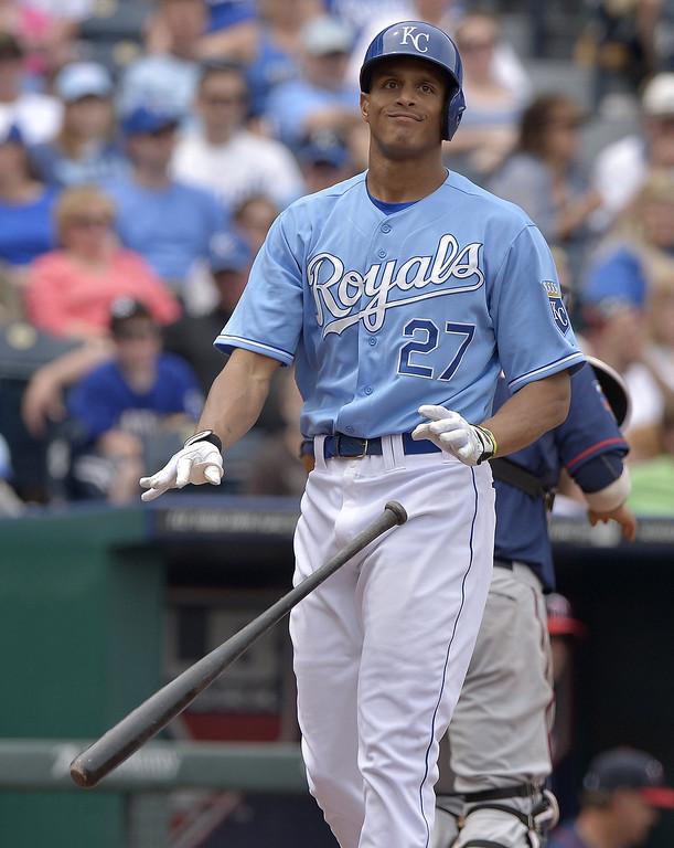 . The Kansas City Royals\' Justin Maxwell (27) flips his bat after striking out to end the fourth inning. (John Sleezer/Kansas City Star/MCT)