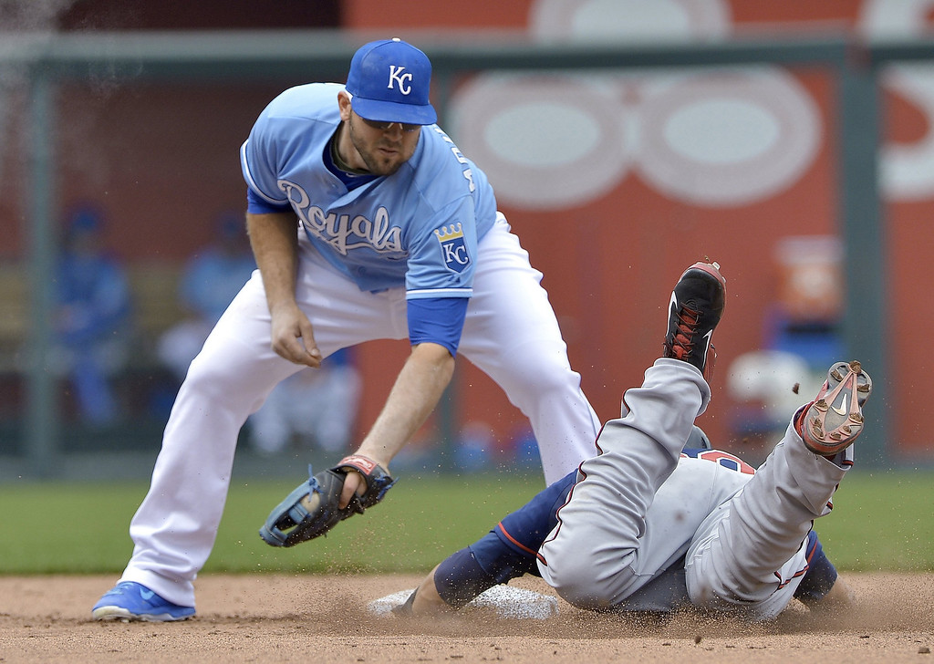 . Kansas City Royals third baseman Mike Moustakas (8) tags out Minnesota Twins\' Chris Colabello (20) at second trying to steel in the fifth inning. (John Sleezer/Kansas City Star/MCT)