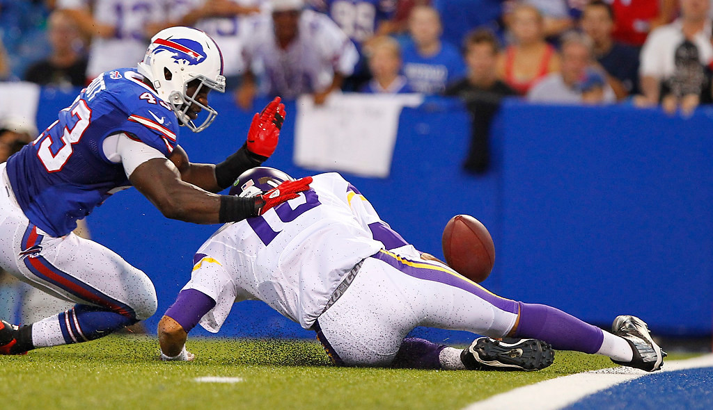 . Buffalo Bills\' Bryan Scott (43) pressures Minnesota Vikings\' Matt Cassel (16) to recover a fumble during the first half of an NFL preseason football game Friday, Aug. 16, 2013, in Orchard Park, N.Y.  (AP Photo/Bill Wippert)