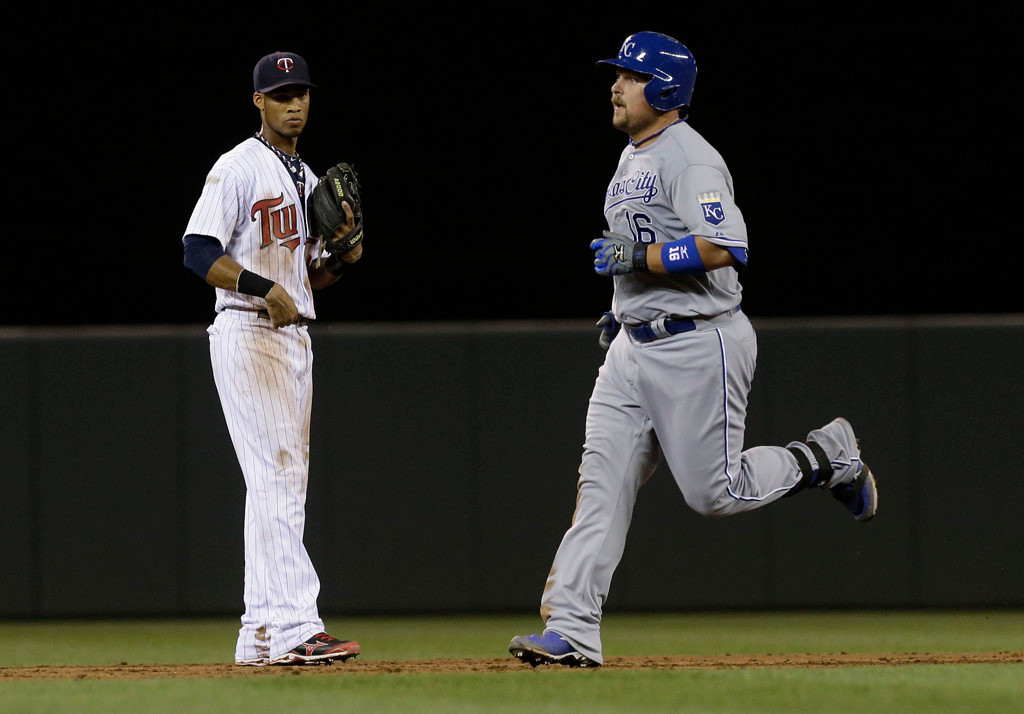 . Minnesota Twins shortstop Pedro Florimon, left, watches as Kansas City Royals\' Billy Butler rounds the bases after hitting a solo home run off Minnesota Twins pitcher Ryan Pressly in the ninth inning.  (AP Photo/Jim Mone)