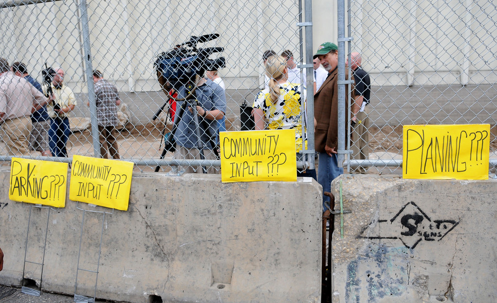 . Mayoral Candidate Tim Holden\'s protestors lined up signs along the fence during the Saint Paul Saints ballpark site demolition.(Pioneer Press: Sherri LaRose-Chiglo)
