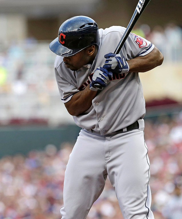 . Cleveland Indians\' Michael Bourn avoids a close pitch from Minnesota Twins pitcher Kevin Correia in the fourth inning. (AP Photo/Jim Mone)