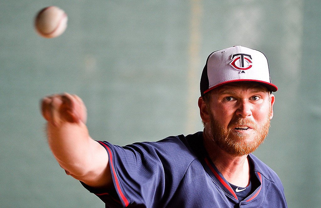 . Twins bullpen candidate Michael Tonkin releases a pitch in the bullpen. (Pioneer Press: Ben Garvin)