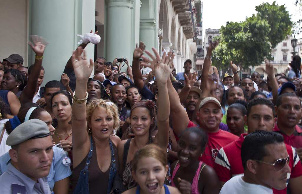 . People react to the press as they wait outside the Saratoga hotel to see Beyonce in Old Havana. (Associated Press: Ramon Espinosa)