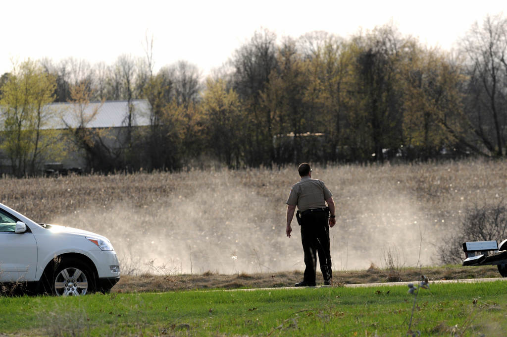 . A sheriff\'s deputy watches a airboat seach the swampy area around where a body believed to be that of Danielle Jelinek was found Chisago Township on Friday May 10, 2013. (Pioneer Press: Jean Pieri)