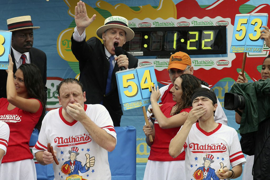 """. 9. COMPETITIVE EATING <p>Surprising it took this long to kill somebody. (unranked) <p><b><a href=\'http://www.twincities.com/breakingnews/ci_26108430/man-dies-at-south-dakota-hot-dog-eating\' target=\""""_blank\""""> LINK </a></b> <p>    (AP Photo/John Minchillo)"""