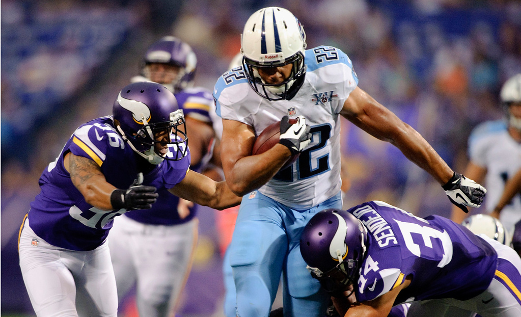 . Minnesota\'s Robert Blanton, left and Andrew Sendejo, right, tackle Tennessee\'s Jackie Battle during the first quarter. (Photo by Hannah Foslien/Getty Images)