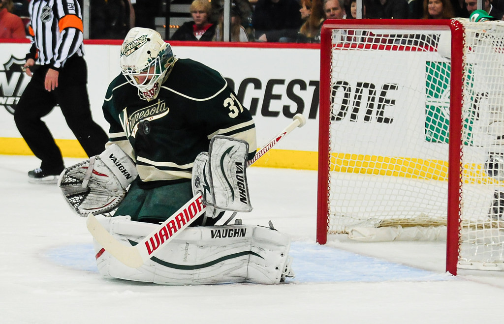 . Wild goalie Josh Harding makes a save against the Balckhawks in the first period.   (Pioneer Press: Ben Garvin)