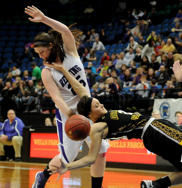 . DeLaSalle Islanders forward Claire Thomas (20) falls to the floor after getting fouled by Red Wing Wingers forward Macy Kelly (25) in the second half. (Pioneer Press: John Autey)