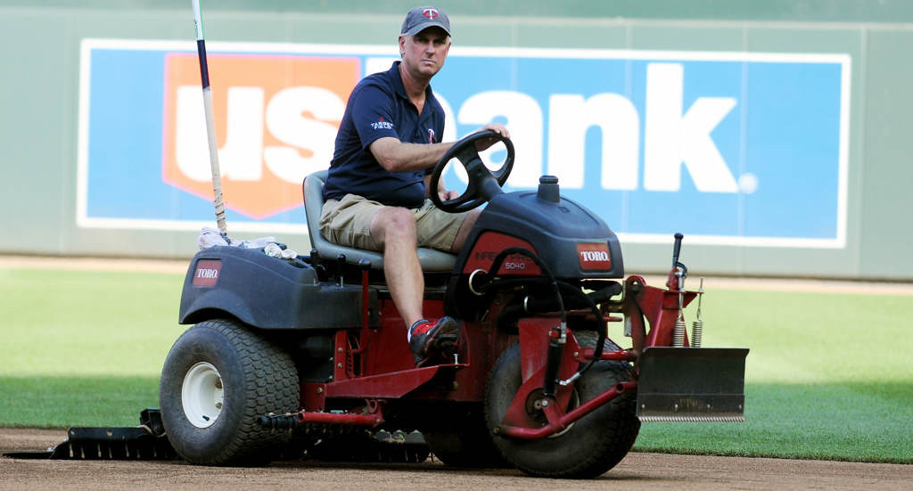 . Head groundskeeper Larry DiVito uses a small tractor to sweep the infield before the start of a game against the Yankees. (Pioneer Press: John Autey)