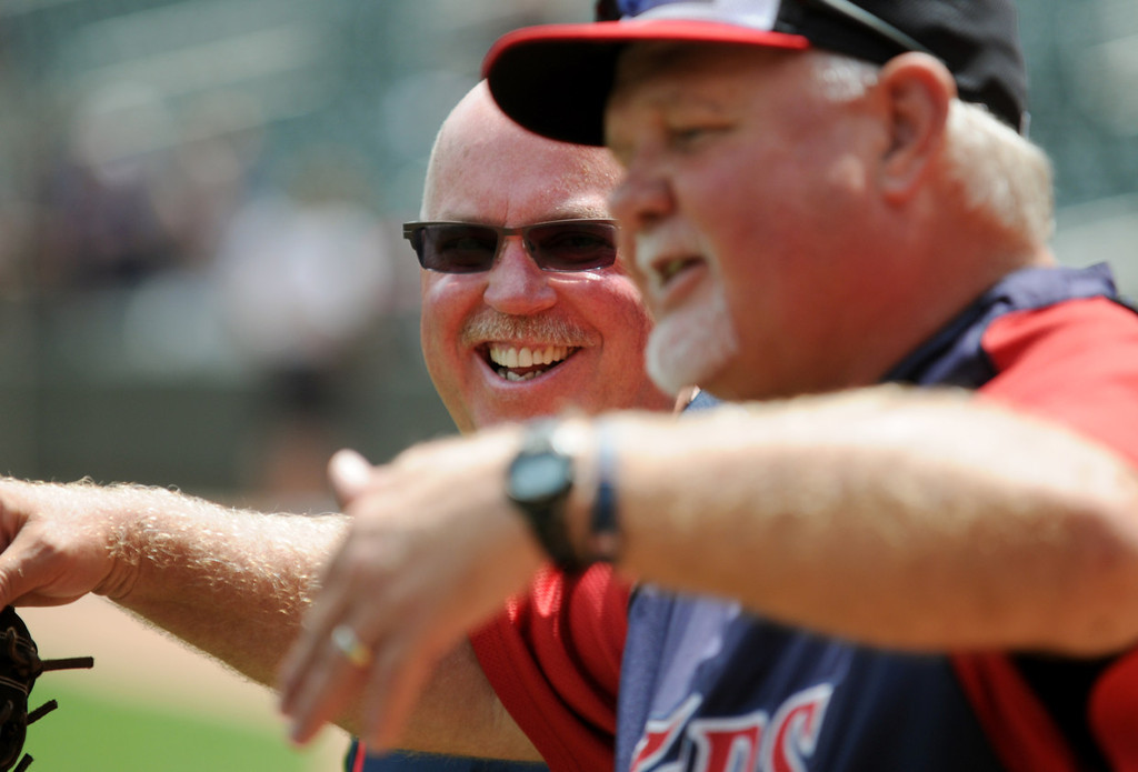 . Minnesota Gophers football coach Jerry Kill laughs as Twins manager Ron Gardenhire tells a story before the start of Saturday\'s game. (Pioneer Press: John Autey)