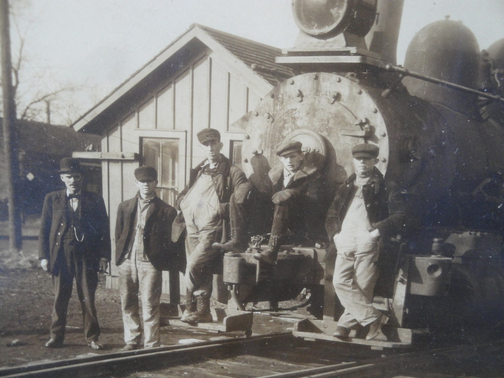 . The Permanent Family RecordWrites JOHN IN HIGHLAND: �This is a century-old photograph of my grandfather and his railroad crew. It was taken in 1914 in the rail yard at Streator, Illinois. John is the young-looking guy, second from the left.   �John dated and married a local farm girl, my grandmother Alice. Her father was never very happy with John. He always thought that his daughter could have done better than to marry a �railroad man.�   �My dad, Ed, told me that after school he would often walk toward the rail yards, meet his dad and carry his lunch pail as they returned home. One day he told Grandpa that when he grew up, he wanted to work on the railroad. In a stern voice, John said: �No child of mine is going to work on the railroad! You are going to college!�   �As it turned out, Ed and all six of his siblings did go to college, and none of them ever worked on the railroad.�