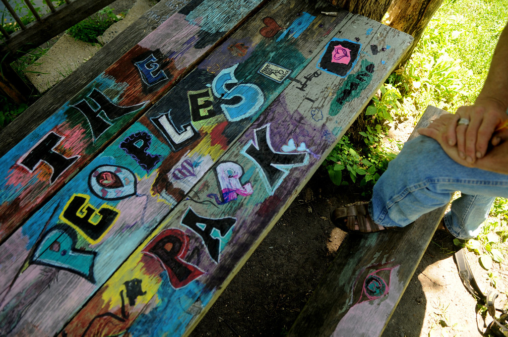 ". Arjo Adams looks at the picnic table that someone painted in the ""People\'s Park.\"" \""It\'s good,\"" he said. \""If you provide art tools people will do almost anything,\"" he said. \""This just happened.\"""