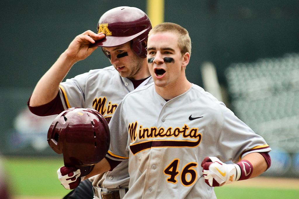 . Minnesota catcher Matt Halloran reacts after running the bases on his three-run home run in the fifth inning. (Pioneer Press: Ben Garvin)