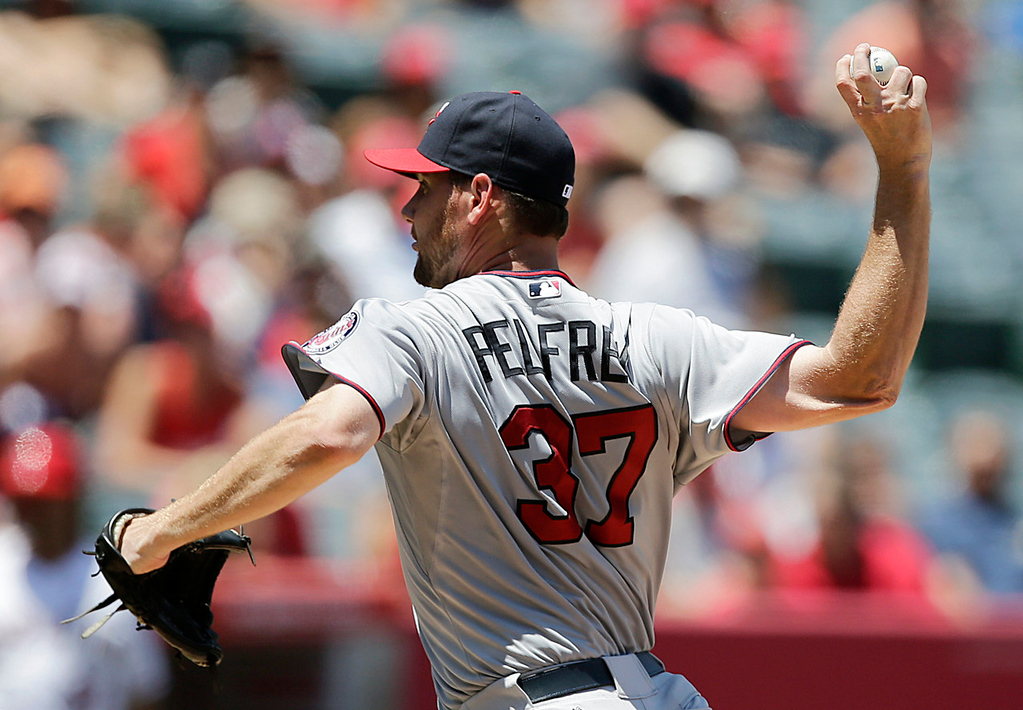 . Twins starting pitcher Mike Pelfrey throws against the Angels during the third inning. (AP Photo/Jae C. Hong)