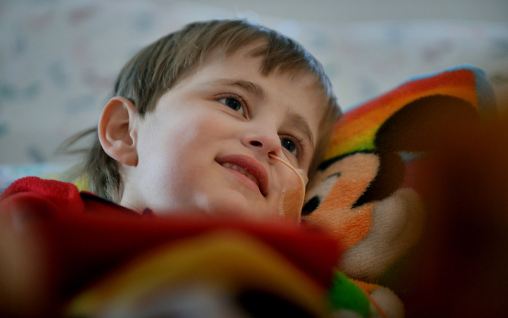 . Cameron Ulrich smiles while watching a favorite cartoon in his hospital room.   (Pioneer Press: Richard Marshall)