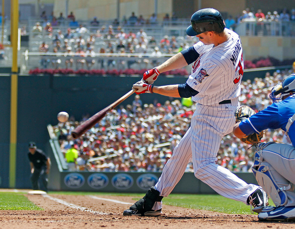 . Minnesota\'s Justin Morneau connects for a solo home run against Royals starter James Shields in the third inning. (AP Photo/Andy Clayton-King)