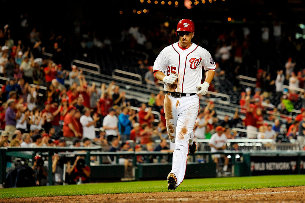 . Adam LaRoche #25 of the Washington Nationals scores a run on a double hit by Ian Desmond #20 in the seventh inning during game two of a doubleheader against the Minnesota Twins at Nationals Park on June 9, 2013 in Washington, DC.  (Photo by Patrick McDermott/Getty Images)