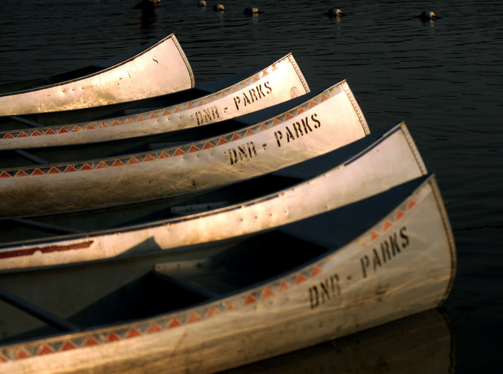 . Aluminum canoes lined up on the beach. (Pioneer Press: Chris Polydoroff)