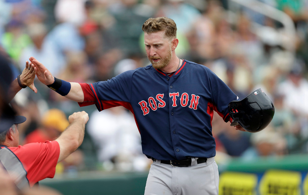 . Boston\'s Mike Carp celebrates after scoring on an RBI single by teammate Derrik Gibson in the sixth inning against the Twins. (AP Photo/Gerald Herbert)