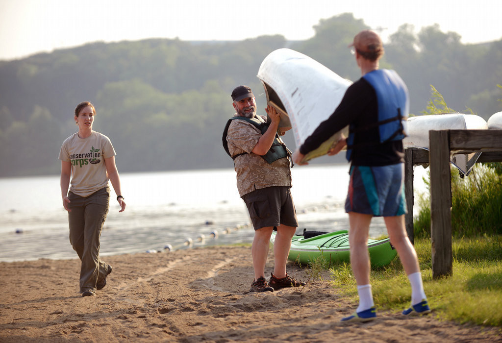 ". ""I Can Paddle\"" program instructor Jen Wendland, left, supervises participants as canoes are carried from the racks to the lakeshore  at Fort Snelling State Park. (Pioneer Press: Chris Polydoroff)"