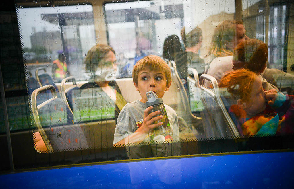 . A child rides opening day of the Metro Transit Green Line light rail train in St. Paul .  (Pioneer Press: Ben Garvin)