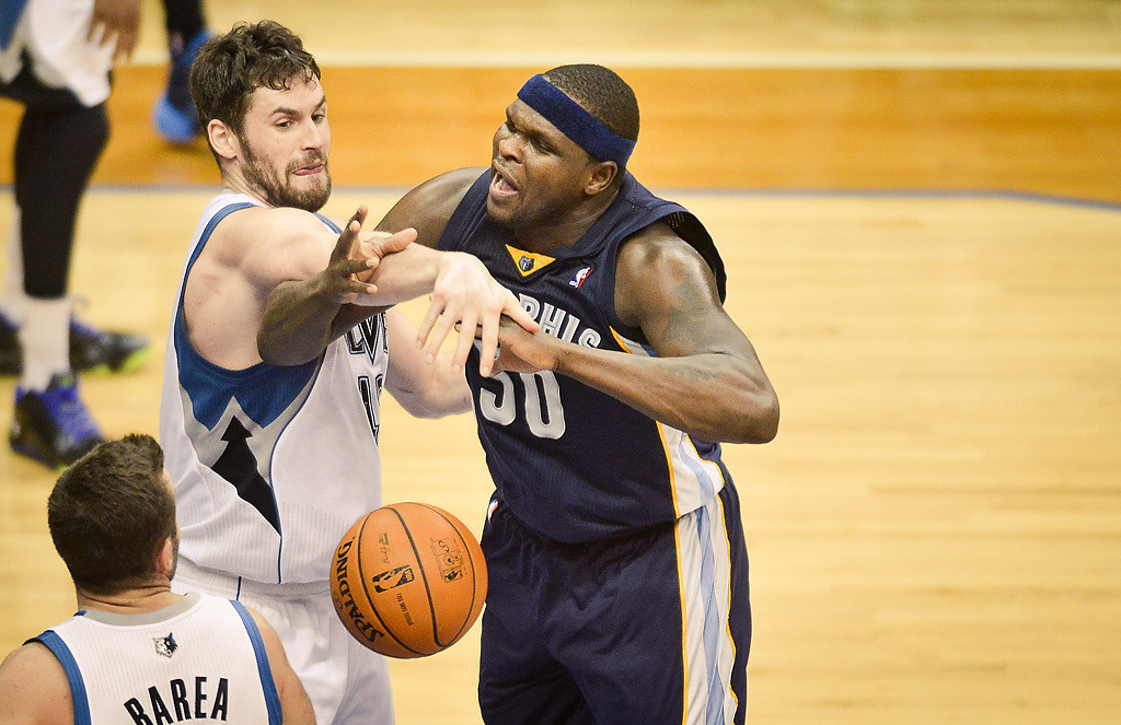 . Minnesota Timberwolves power forward Kevin Love fouls Memphis Grizzlies power forward Zach Randolph hard late in the fourth quarter. (Pioneer Press: Ben Garvin)