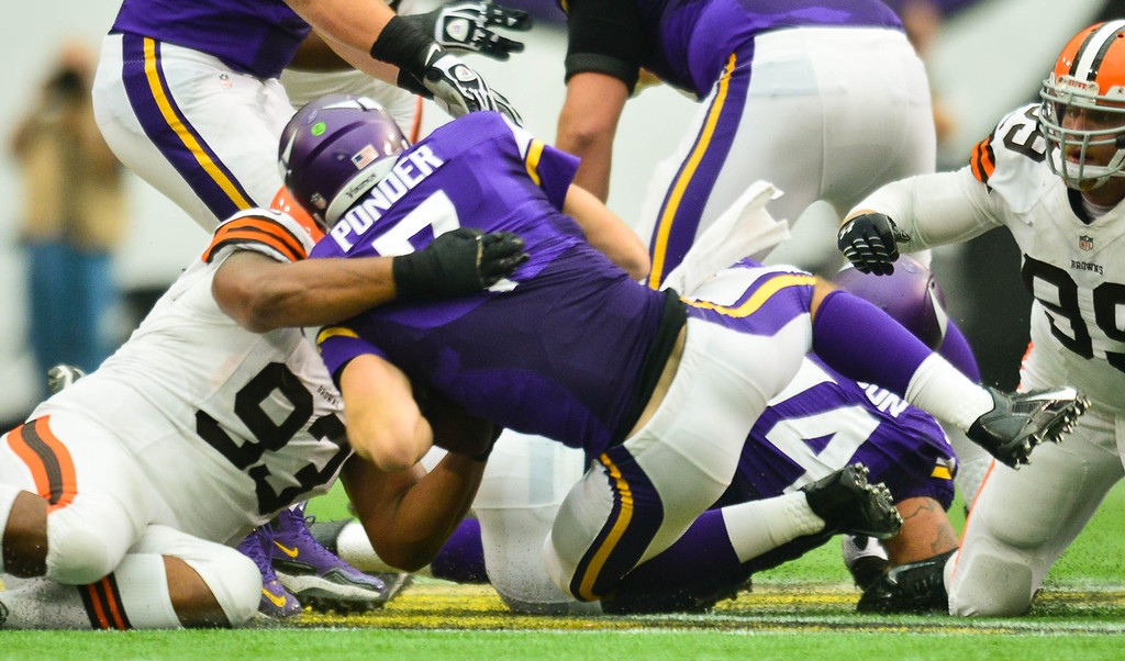 . Vikings quarterback Christian Ponder is sacked by Cleveland defensive tackle John Hughes for a 6-yard loss in the third quarter. (Pioneer Press: Ben Garvin)