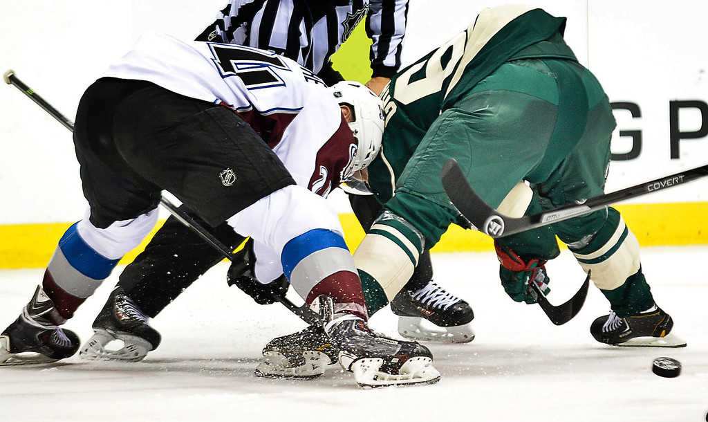 . Colorado Avalanche right wing Marc-Andre Cliche, left, and Minnesota Wild center Mikael Granlund face off in the second period. (Pioneer Press: Ben Garvin)