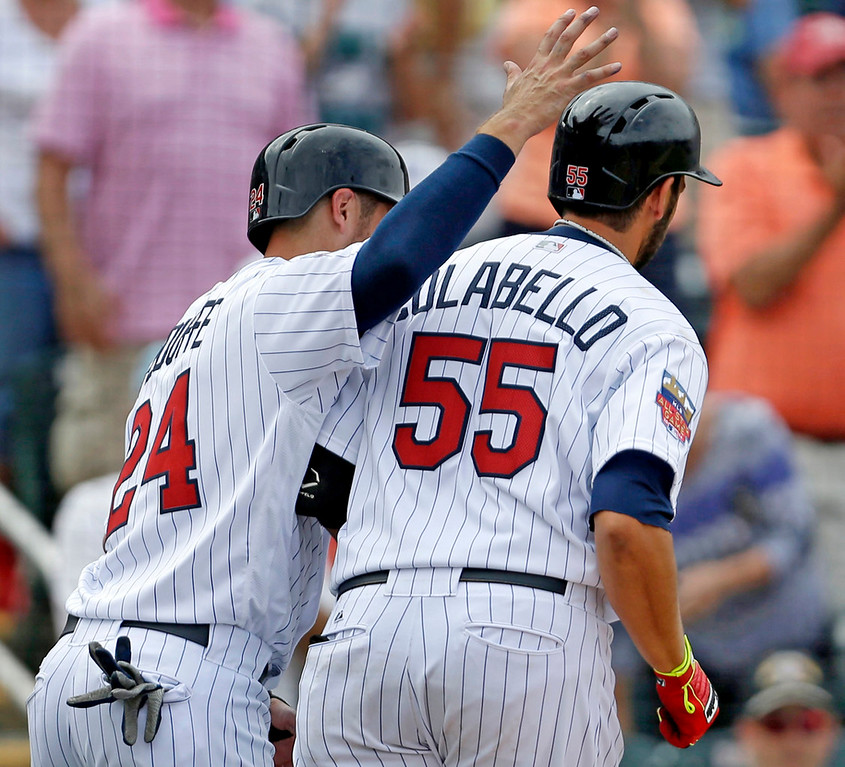 . Colabello, right, gets an attaboy from teammate Trevor Plouffe after the two scored on Colabello\'s two-run homer in the sixth inning. (AP Photo/Gerald Herbert)