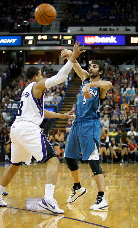 . Minnesota Timberwolves guard Ricky Rubio (9) passes the ball over Sacramento Kings defender Ray McCallum during the first half.(AP Photo/Steve Yeater)