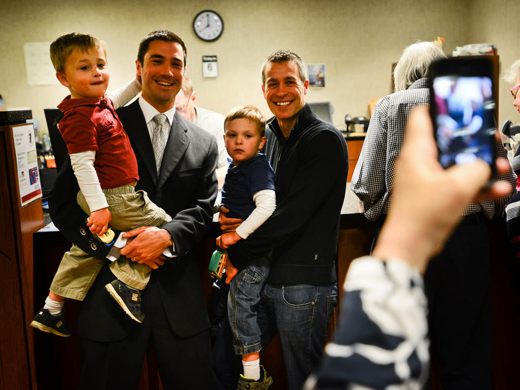 . James Zimmerman, left, and his partner Dr. Paul Melchert, both of Minneapolis, pose for a photo holding their twin boys Emmett and Gabriel after they applied for their Minnesota marriage license Thursday. (Pioneer Press: Ben Garvin)