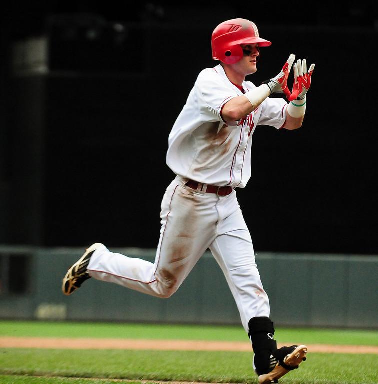 . Nebraska second baseman Pat Kelly runs the bases after hitting a three-run homer in the fourth inning. (Pioneer Press: Ben Garvin)