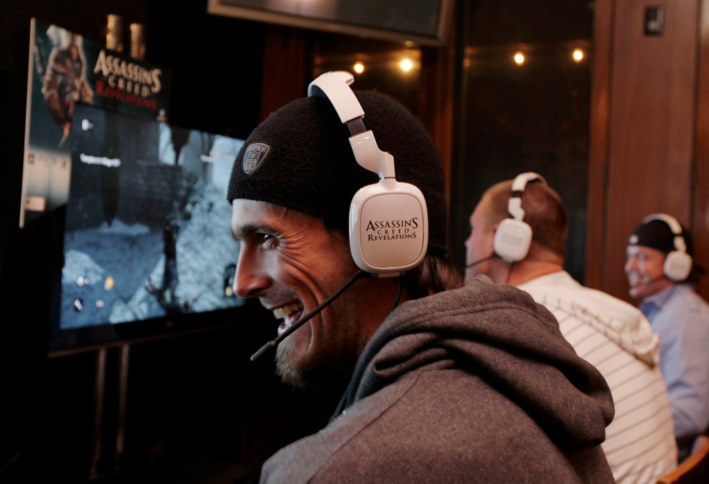. Minnesota Vikings\' Chris Kluwe and teammates play Ubisoft\'s Assassin\'s Creed Revelations on PlayStation 3 against division rival Green Bay Packers on Tuesday, November 8, 2011 in Eden Prairie. (Genevieve Ross/AP Images for Ubisoft)