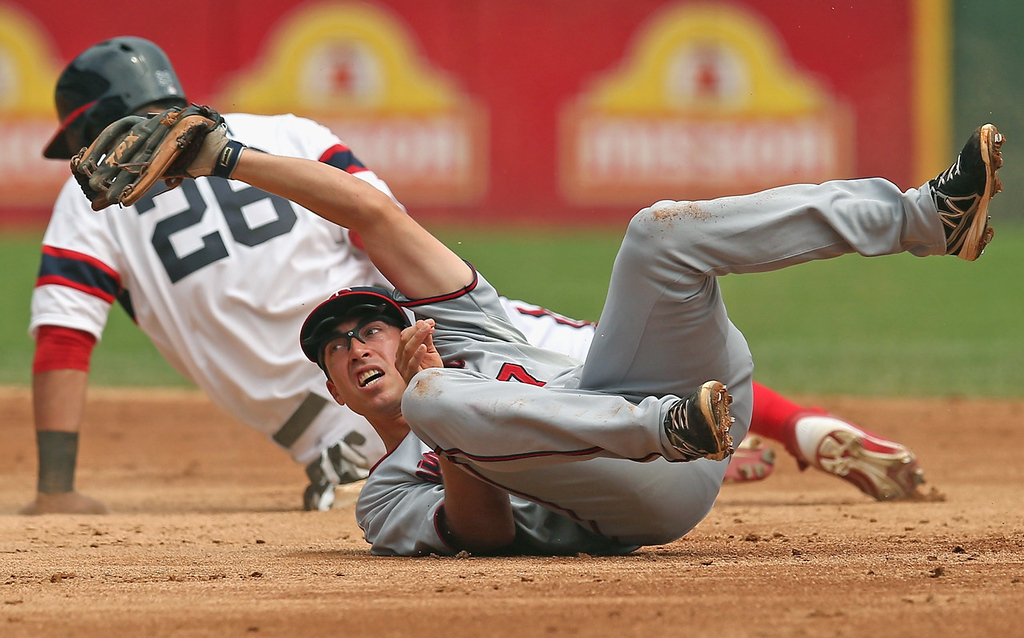 . Twins shortstop Doug Bernier looks at the umpire after missing the tag as White Sox base runner Avisail Garcia steals second base in the second inning.  (Photo by Jonathan Daniel/Getty Images)