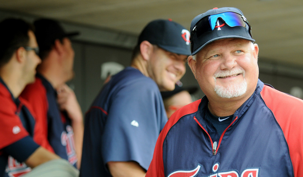 . Minnesota manager Ron Gardenhire enjoys a laugh in the dugout in the seventh inning. (Pioneer Press: John Autey)